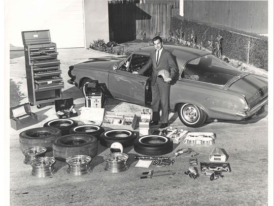 Gas Ronda with the spoils of a successful year of drag racing, circa mid-1960s. He won the car and everything else in the foreground of the photo.