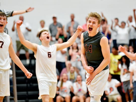 Northeastern's Jacob Cheuvront celebrates after the Bobcats won the fifth set of a YAIAA boys' volleyball match Thursday, May 10, 2018, at Northeastern. Northeastern defeated Central 3-2 (20-25, 21-25, 25-16, 25-14, 15-7) to win the regular-season YAIAA title.