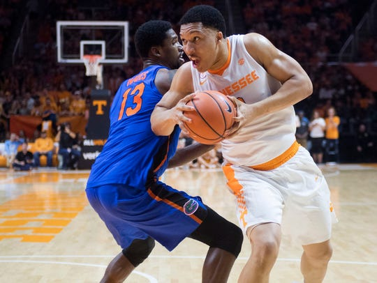 Tennessee's Grant Williams works his way around Florida's