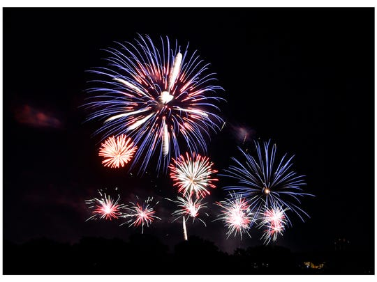 Fireworks explode in the night sky over the Nelson Park lake on July 4, 2018. Thousands lined the park, the Taylor County Expo Center, Shotwell Stadium, as well as neighborhoods and streets for blocks in all directions to see the WesTex Connect Fireworks Spectacular. The event returns next week.