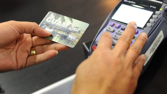 Additional information is entered on an electronic benefit transfer terminal during a customer's purchase at the American Grocery store in Dededo on Tuesday, April 5, 2016.