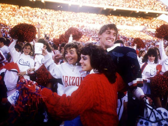 Fans mob UA's Chuck Cecil after the Wildcats defeat Arizona State in 1986.