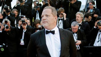 Multiple outlets report that disgraced Hollywood studio boss Harvey Weinstein, seen here at the 2013 Academy Awards, will surrender to authorities in New York Friday.