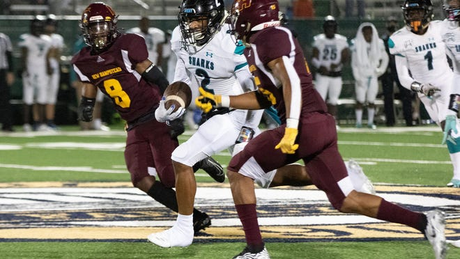 Deion Duncan of Islands runs for a big gain after a reception setting up an Islands touchdown in a win over New Hampstead Friday night.