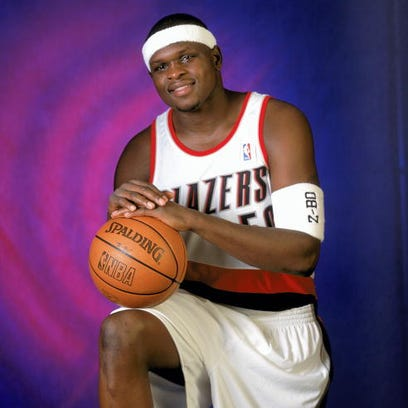 PORTLAND, OR - FEBRUARY 19:  Zach Randolph #50 of the Portland Trail Blazers lays up a shot during the NBA game against the Golden State Warriors at Rose Garden on February 19, 2003 in Portland, Oregon.  The Trail Blazers won 125-98.  NOTE TO USER: User expressly acknowledges and agrees that, by downloading and/or using this Photograph, User is consenting to the terms and conditions of the Getty Images License Agreement.  (Photo by Jonathan Ferrey/Getty Images)