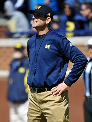 Jim Harbaugh attended the Swing to Cure Diabetes on Monday at UM Golf Course, which was hosted by former teammate Rich Hewlett.