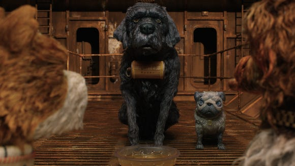 "F. Murray Abraham as Jupiter and Tilda Swinton as Oracle in ""Isle of Dogs."""
