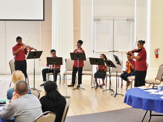 The Gifford Youth Orchestra performed at the School District of Indian River County's Principals Luncheon in December.