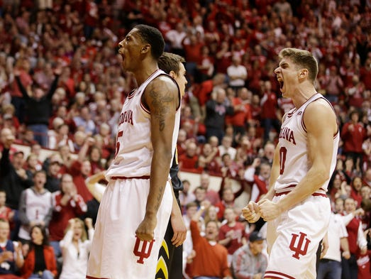 Indiana's Troy Williams (5) and Collin Hartman (30)