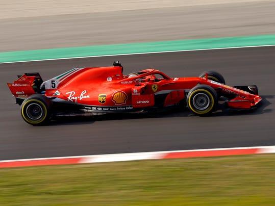 Ferrari driver Sebastian Vettel of Germany steers his car during a Formula One pre-season testing session at the Catalunya racetrack in Montmelo, outside Barcelona, Spain, Tuesday, Feb. 27, 2018. (AP Photo/Francisco Seco)