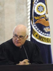 U.S. District Judge W. Keith Watkins talks briefly before swearing in George Beck as U.S. Attorney for the Middle District of Alabama at the Federal Courthouse in Montgomery on July 6, 2011. Watkins ordered former KKK leader Steven Joshua Dinkle, 30, back to prison for 10 months.