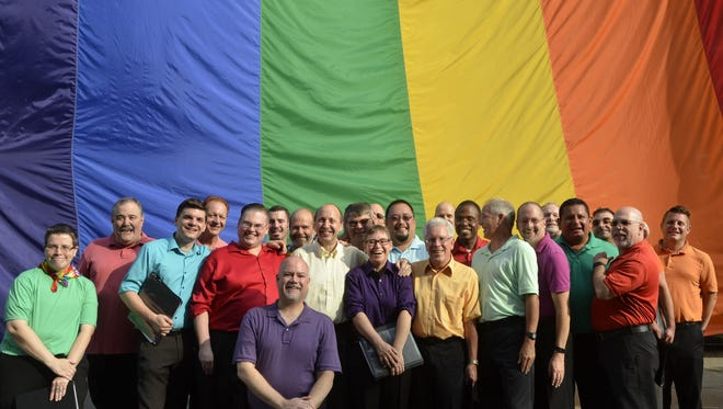 Members of the Rochester Gay Men's Chorus  performed at the opening ceremonies for Roc Pride 2018 at Rochester City Hall on July 16.