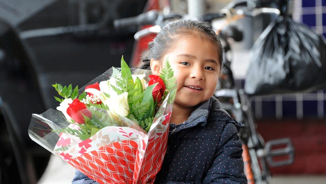 Yuritza Hernandez, 6, with flowers for her mother from Flores Maryfer in east Salinas.