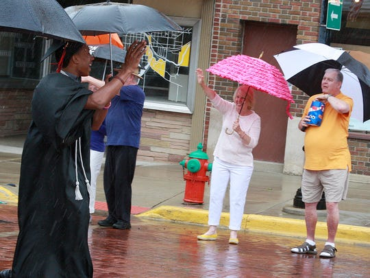 Parents and Marshall High School Graduates waved at each other during their parade through Downtown Albion Saturday afternoon