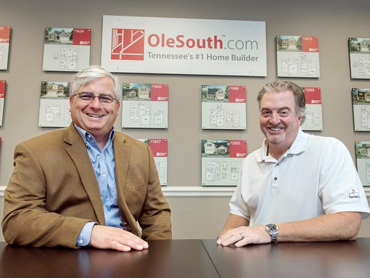 MTSU professor Colby Jubenville, left, is shown with philanthropist and Midstate homebuilder John Floyd of Ole South Properties in this fall 2016 photo inside Ole South offices. Floyd pledged $1 million to help launch the new MTSU Center for Student Coaching and Success, which will be directed by Jubenville.