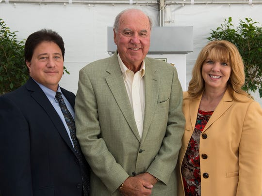 Treasure Coast Food Bank Board Chair Miguel Coty, H. William Lichtenberger, and Treasure Coast Food Bank President and CEO Judith Cruz