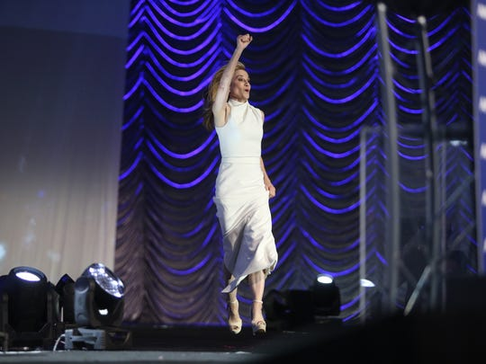 Holly Hunter leaps into the air as she walks on stage to accept her award Tuesday at the Palm Springs International Film Festival.