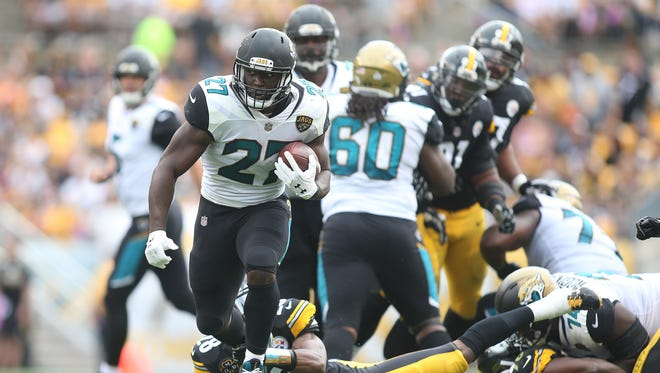 Jacksonville Jaguars running back Leonard Fournette (27) rushes the ball against the Pittsburgh Steelers during the first quarter at Heinz Field.
