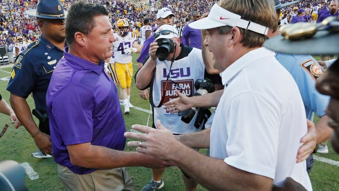 LSU coach Ed Orgeron, left, is congratulated by Georgia coach Kirby Smart after an NCAA college football game Saturday, Oct. 13, 2018, in Baton Rouge, La. (Bob Andres/Atlanta Journal Constitution via AP)
