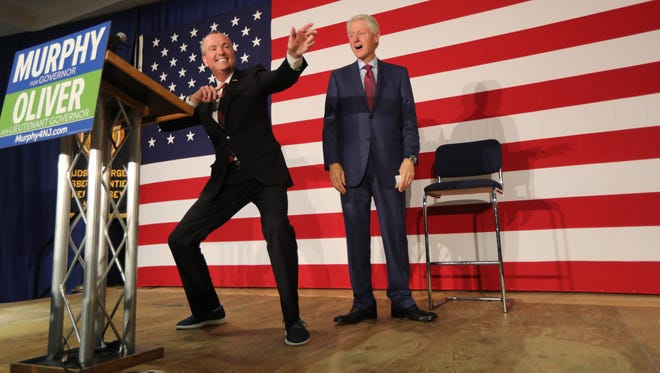 Phil Murphy shows his excitement to have Bill Clinton campaigning with him in Paramus on Tuesday, Oct. 24, 2017.