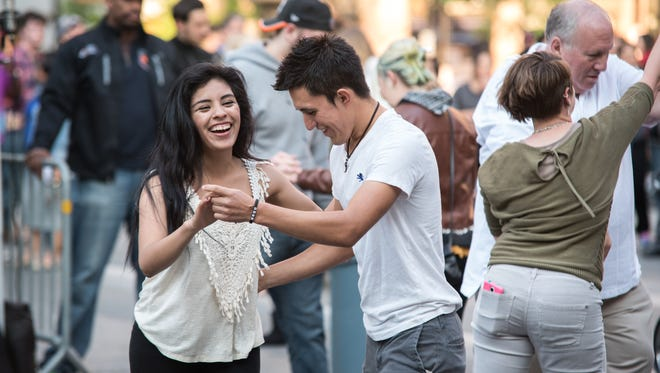 Kelly Rosete and Jose Trejo of Covington, Ky, come to Fountain Square's first Salsa on the Square of the season on Cinco de Mayo, May 5, 2016.