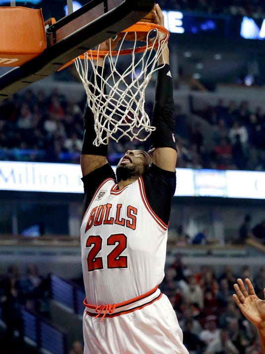 Chicago Bulls forward Taj Gibson dunks against the Utah Jazz during the first half of an NBA basketball game Saturday, March 19, 2016, in Chicago. (AP Photo/Nam Y. Huh)