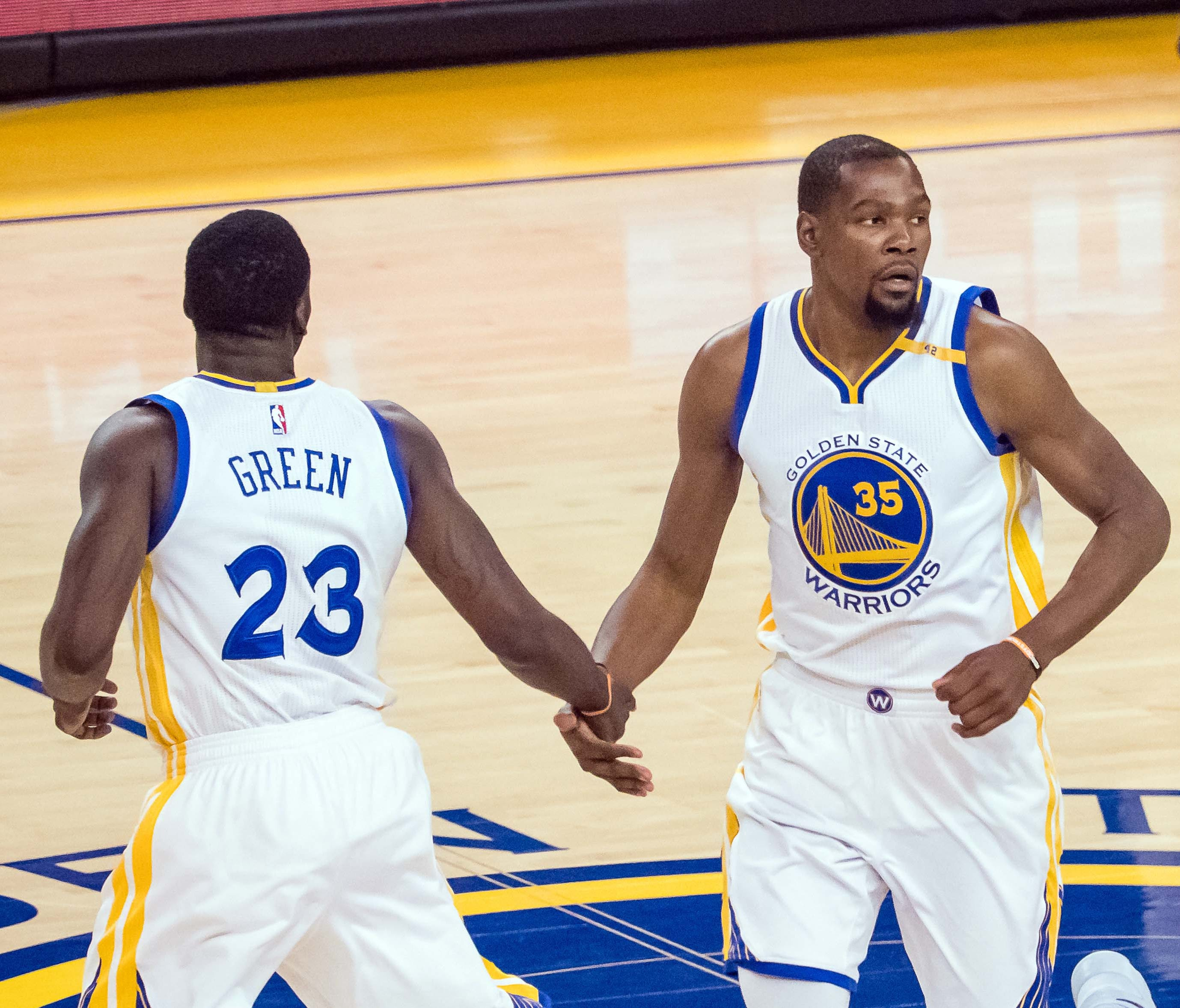 The Golden State Warriors' Kevin Durant (35) and Draymond Green enjoyed a Game 2 rout of the Spurs.