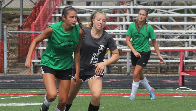Badin's Malia Berkely takes the ball upfield in the July 12 game against McAuley at Fairfield.