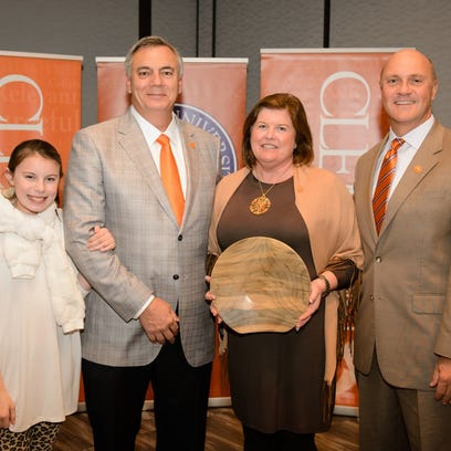 The McBrides with Clemson President James P. Clements.