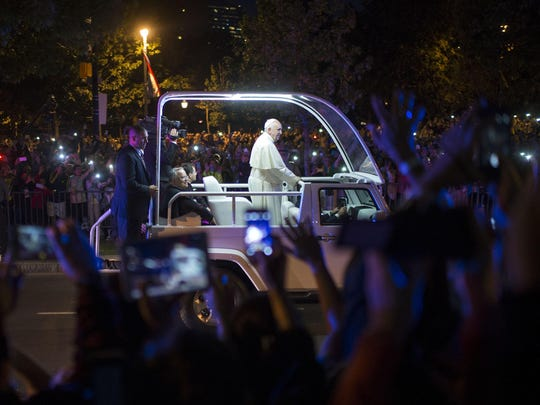 People cheer as Pope Francis travels on the Parkway Saturday, September 26 outside the Philadelphia Museum of Art.