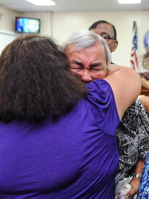 In this August file photo, Leo Tudela, 73, is comforted by Josie Redmond after he testified in support of Bill 326 at the Guam Legislature in Hagatna on Monday, Aug. 1. Tudela testified that as a child, he served as an altar boy with the Mount Carmel Church in Chalan Kanoa, Saipan until he was given the opportunity to attend Catholic school on Guam. Tudela told lawmakers during his testimony that he was sexually abused by three members of Guam's Catholic Church, including a priest, on three different occasions.