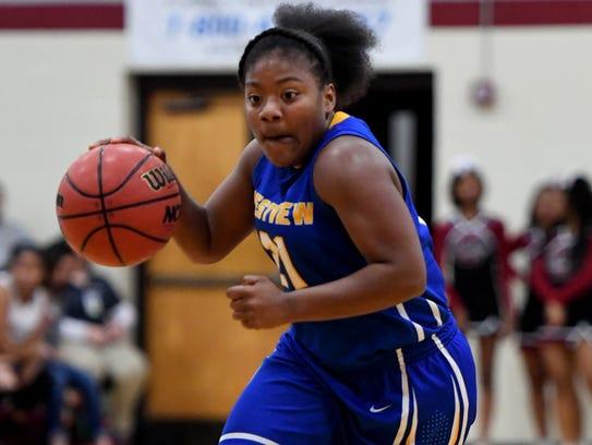 Westview's Tasia Jones dribbles up the open court during