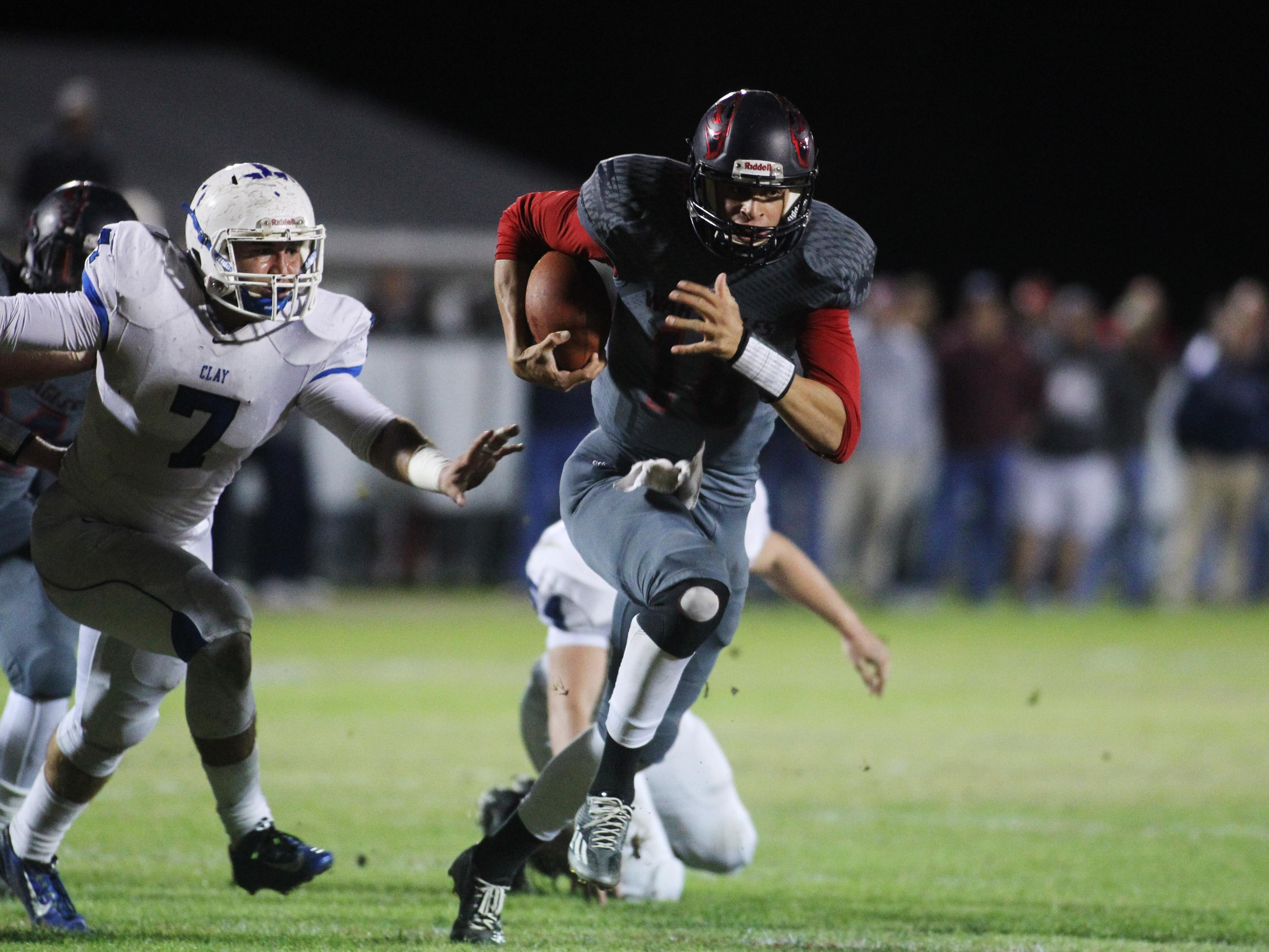 Wakulla quarterback Feleipe Franks runs with the ball in a game between Clay High and Wakulla High.