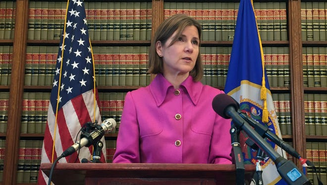 In a Friday Oct. 13, 2017 file photo, Minnesota Attorney General Lori Swanson announces she'll join a lawsuit with California and other states challenging President Donald Trump's decision to halt payments to insurers that had helped hold premiums down for people buying insurance under the Obama-era health care law. Swanson said in an email Sunday, Jan. 28, 2018 that  she plans to run for re-election as attorney general instead of running for governor.  (AP Photo/Kyle Potter, File)