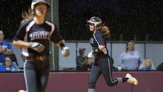 Another Aggies run scores as Amber Decoux (17) draws a walk with the bases loaded during the district championship softball between Tate and Pace high schools at Tate High School on Thursday, April 26, 2018.