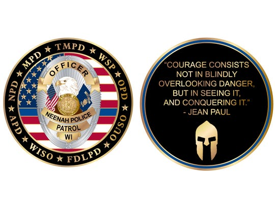 The Neenah Police Department commissioned a challenge coin in remembrance of the Dec. 5 standoff and deadly shooting at Eagle Nation Cycles.