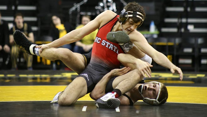 Iowa 141-pounder Brody Grothus wrestles N.C. State's Kevin Jack Monday.