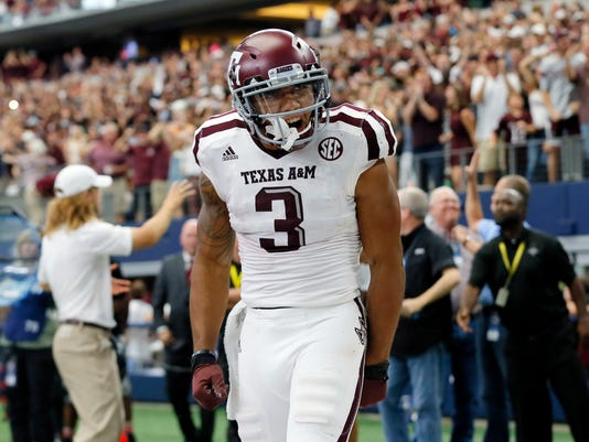 Texas A&M wide receiver Christian Kirk (3) celebrates catching a touchdown pass in overtime of an NCAA college football game against Arkansas on Saturday, Sept. 23, 2017, in Arlington, Texas. (AP Photo/Tony Gutierrez)
