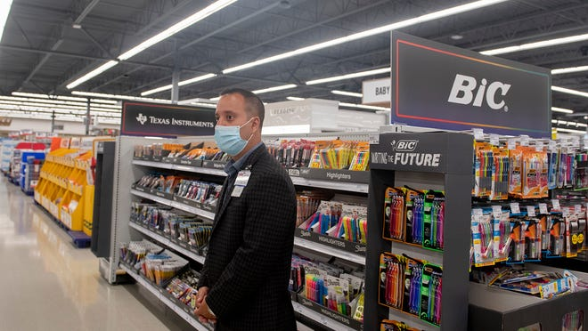 Marco Gomez, Brimfield Meijer store director, shows the Back to School displays. In addition to purchasing standard supplies, parents can start taking a number of actions to prepare for the upcoming school year.