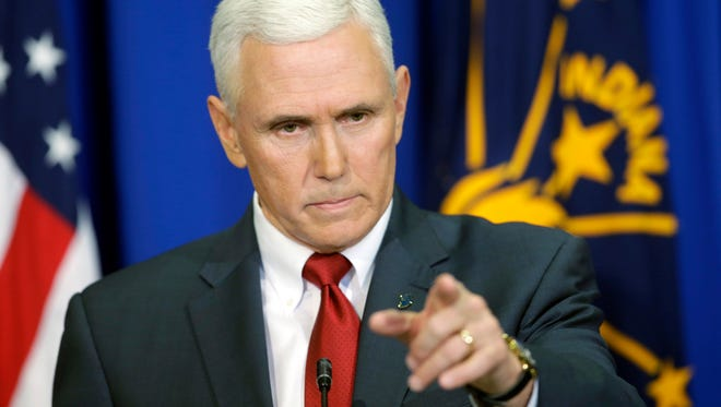 """Then-Indiana Gov. Mike Pence takes a question during a March 31, 2015, news conference discussing the state's new Religious Freedom Restoration Act into law in Indianapolis. Pence faced a firestorm of criticism after signing the """"religious-freedom"""" law critics decried as anti-gay."""