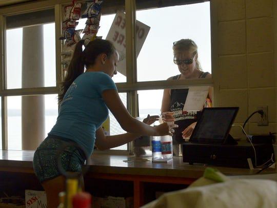 A Beach House VT employee serves a patron at North