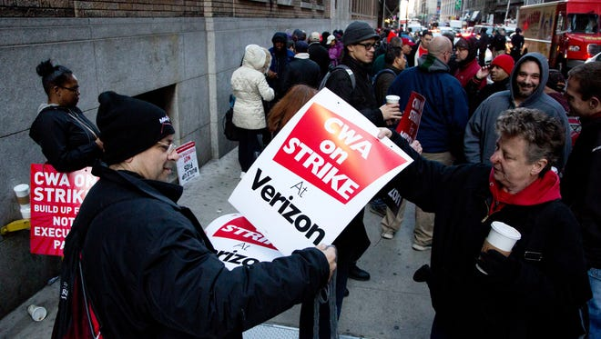 Verizon workers picket in front of a company facility, Wednesday, April 13, 2016, in New York. Tens of thousands of Verizon landline and cable workers on the East Coast walked off the job after little progress in negotiations since their contract expired nearly eight months ago.