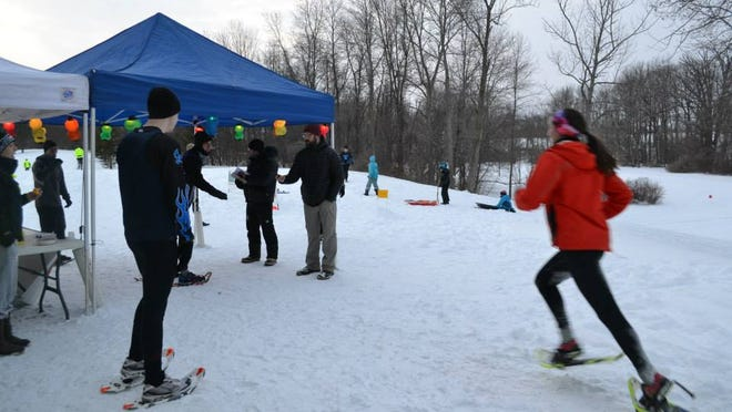 The transition area for Cast a Shadow 6-hour solo or relay snowshoe race in Black Creek Park in Chili on February 8.