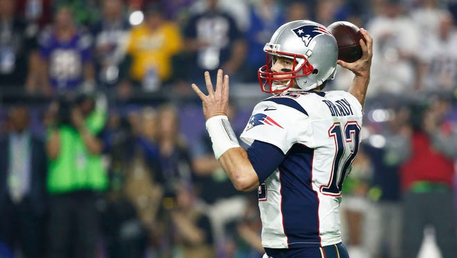 New England Patriots Tom Brady throws a pass against Seattle Seahawks at Super Bowl XLIX on Sunday, Feb. 1, 2015 in Glendale.