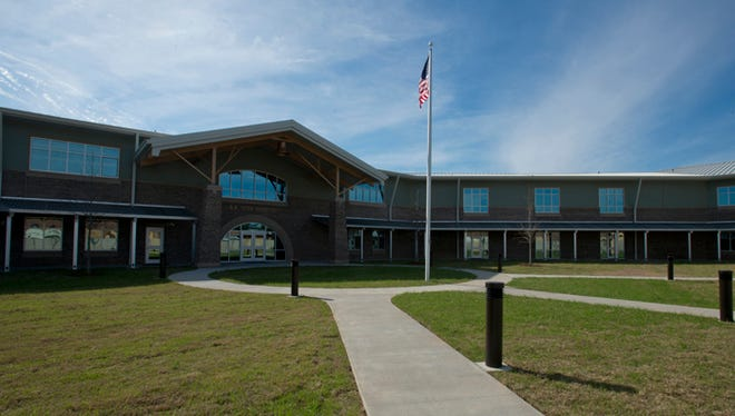 A.K. Suter Elementary School teachers and students receive recognition for energy education.