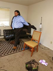 Eric Powell Jr, 24, gets ready for a job interview