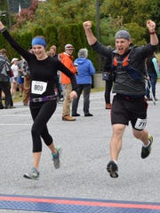 Kyle Mitofsky runs his fast half marathon in October alongside his friend and running-mate Kim Schafrick.