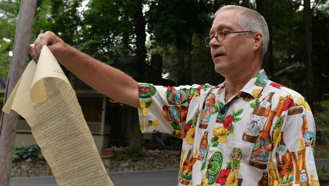 From the sidewalk of his Muhlenberg Avenue home, Mt. Gretna resident Mark Shafernich reads a copy of the Declaration of Independence on Monday, July 4, 2016. The progressive reading was part of a weekend-long celebration hosted by the Pennsylvania Chautauqua.