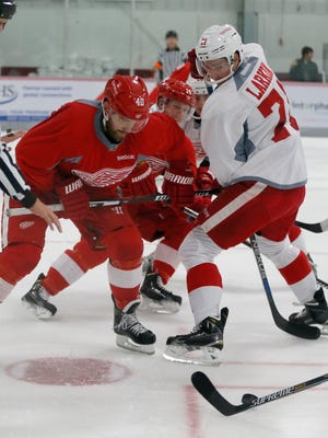 Detroit Red Henrik Zetterberg, left, and Dylan Larkin watch the puck after a face off during a scrimmage game on the team's first day of training camp on Friday, September 18, 2015, in Traverse City. Julian H. Gonzalez/Detroit Free Press
