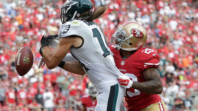 San Francisco 49ers defensive back Chris Culliver, right, breaks up a pass in the end zone intended for Philadelphia Eagles wide receiver Riley Cooper during the fourth quarter of an NFL football game in Santa Clara, Calif., Sunday, Sept. 28, 2014. The 49ers won 26-21. (AP Photo/Marcio Jose Sanchez)